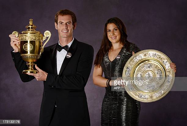 Britain's tennis player Andy Murray and French Marion Bartoli pose with their 2013 Wimbledon trophies during the Wimbledon Champions Dinner in...
