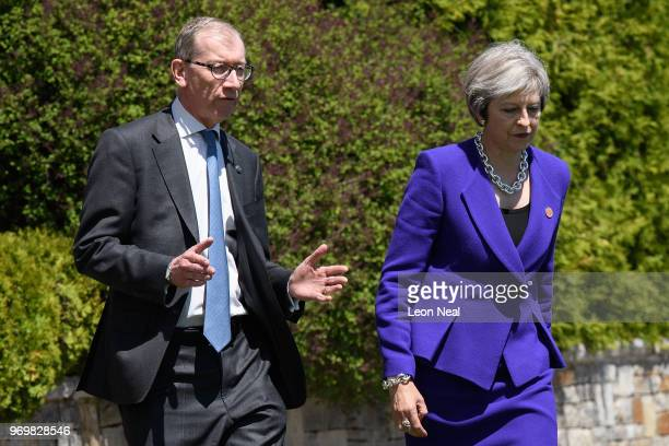 Britain's Theresa May and her husband Philip May prepare to be greeted by Canada's Prime Minister Justin Trudeau and his wife Sophie Gregoire during...