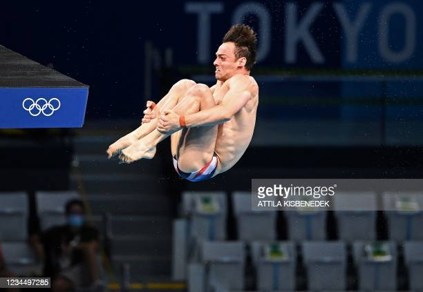 Britain's Thomas Daley competes in the preliminary round of the men's 10m platform diving event during the Tokyo 2020 Olympic Games at the Tokyo...