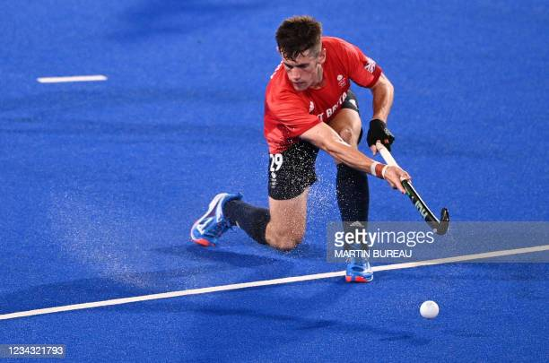 Britain's Thomas Sorsby strikes the ball during the men's pool B match of the Tokyo 2020 Olympic Games field hockey competition against Belgium, at...
