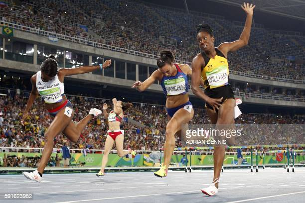 Britain's Tiffany Porter Belarus' Alina Talay Croatia's Andrea Ivancevic and Jamaica's Shermaine Williams compete in the Women's 100m Hurdles...