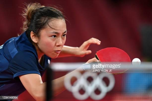 Britain's Tin-Tin Ho serves to India's Manika Batra during their women's singles round 1 table tennis match at the Tokyo Metropolitan Gymnasium...