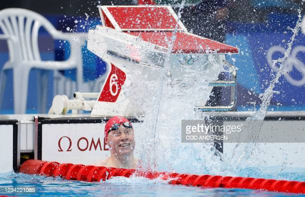 Britain's Tom Dean celebrates after winning the final of the men's 200m freestyle swimming event during the Tokyo 2020 Olympic Games at the Tokyo...
