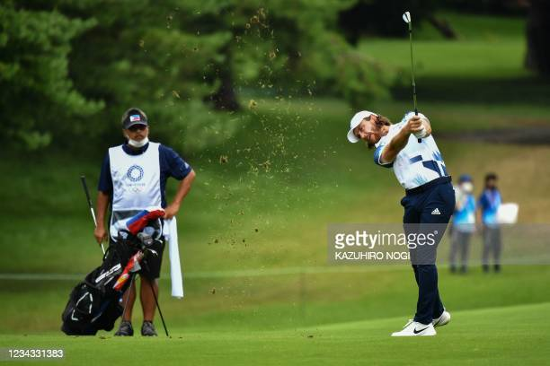 Britain's Tommy Fleetwood plays a shot on the 1st hole in round 3 of the mens golf individual stroke play during the Tokyo 2020 Olympic Games at the...