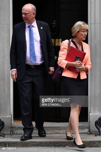 Britain's Transport Secretary Chris Grayling and Britain's Leader of the House of Commons Andrea Leadsom leaves 10 Downing Street in central London...