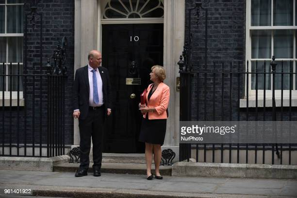 Britain's Transport Secretary Chris Grayling and Britain's Leader of the House of Commons Andrea Leadsom leave 10 Downing Street after attending the...