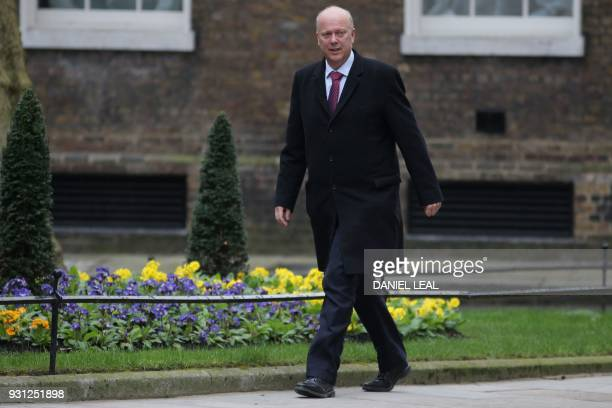 Britain's Transport Secretary Chris Grayling arrives at 10 Downing Street in central London on March 13 2018 to attend the weekly meeting of the...