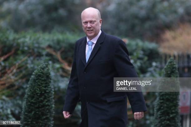 Britain's Transport Secretary Chris Grayling arrives in Downing street for the weekly cabinet meeting in London on February 20 2018 / AFP PHOTO /...