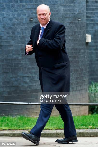 Britain's Transport Secretary Chris Grayling arrives in Downing street on central London on March 6 2018 for the weekly meeting of the Cabinet / AFP...