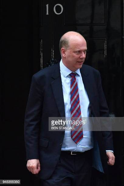 Britain's Transport Secretary Chris Grayling leaves after an emergency cabinet meeting at 10 Downing street in London on April 12 2018 Britain's...