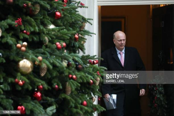 Britain's Transport Secretary Chris Grayling leaves after attending the weekly meeting of the cabinet at 10 Downing Street in London on December 4...