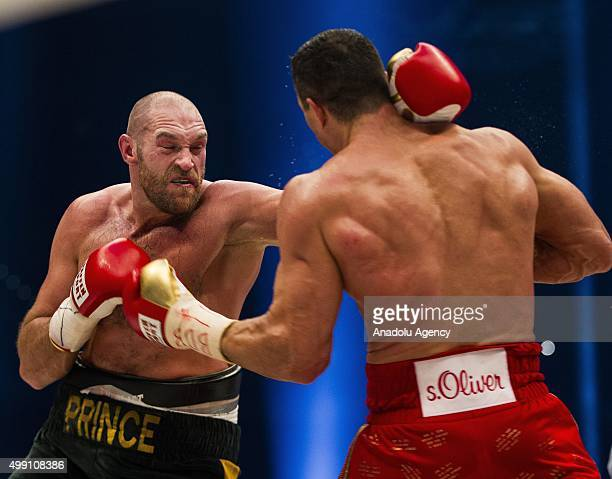 Britain's Tyson Fury and Ukraine's Wladimir Klitschko in action during their IBF/IBO/WBA/WBO World Heavyweight Championship title fight at the Esprit...