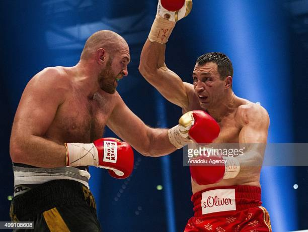 Britain's Tyson Fury and Ukraine's Wladimir Klitschko in action during their IBF/IBO/WBA/WBO World Heavyweight Championship title fight at the Esprit...
