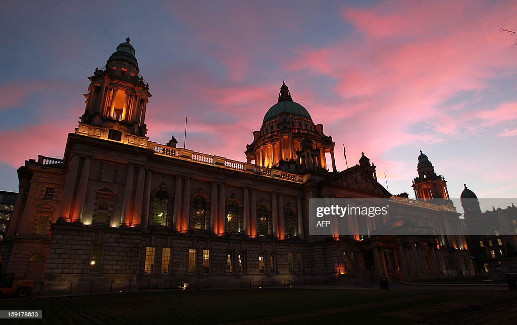Britain's Union flag flies at dusk at the Belfast City Hall in Belfast, Northern Ireland, on January 9, 2013 after it was hoisted for the day to mark the Duchess of Cambridge's 31st birthday. The British flag was hoisted over Belfast's City Hall for the first time since the decision not to fly it permanently sparked riots in Northern Ireland.