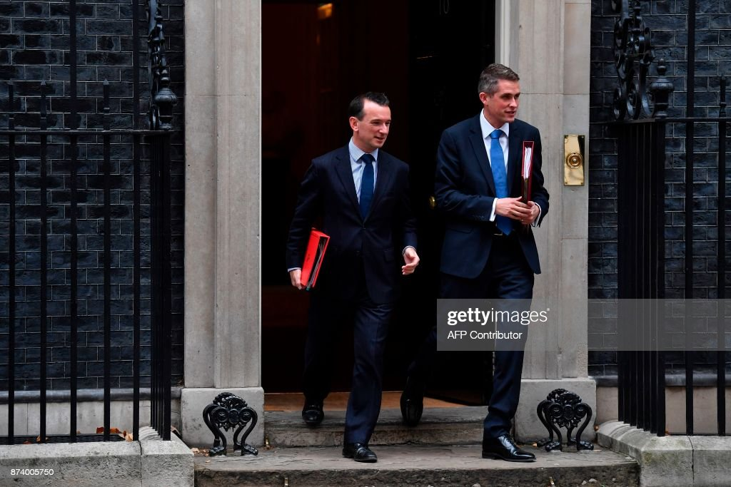 Britain's Wales Secretary Alun Cairns (L) and Britain's Defence Secretary Gavin Williamson leave 10 Downing Street after attending the weekly meeting of the Cabinet in central London on November 14, 2017. British Prime Minister Theresa May begins a major parliamentary battle over Brexit on Tuesday, facing competing demands by MPs to change her strategy as tensions rise among her scandal-hit ministers. MPs will have their first chance to scrutinise the EU Withdrawal Bill, which would formally end Britain's membership of the European Union and transfer four decades of EU legislation into UK law. / AFP PHOTO / Ben STANSALL