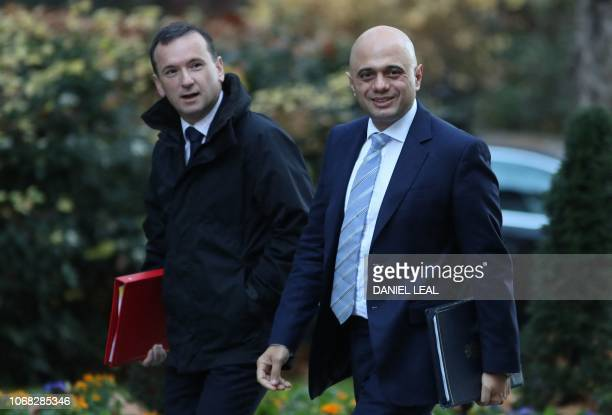 Britain's Wales Secretary Alun Cairns and Britain's Home Secretary Sajid Javid attend the weekly meeting of the cabinet at 10 Downing Street in...