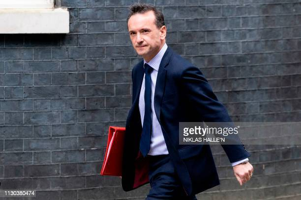 Britain's Wales Secretary Alun Cairns arrives in Downing Street in London on March 14 ahead of a further Brexit vote British MPs will vote today on...