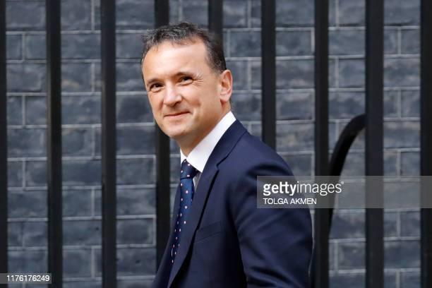 Britain's Wales Secretary Alun Cairns arrives in Downing Street in central London on October 16 2019 for a meeting of the cabinet British Prime...