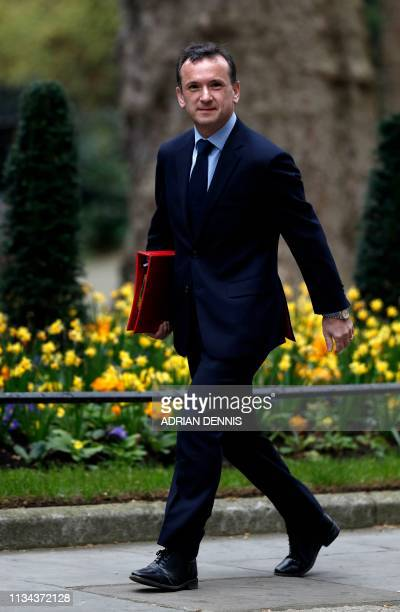 Britain's Wales Secretary Alun Cairns arrives in Downing street London for a cabinet meeting on April 2 2019 The British cabinet is gathering today...