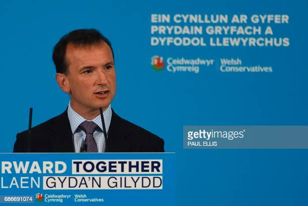 Britain's Wales Secretary Alun Cairns introduces Britain's Prime Minister Theresa May during a launch event for the Welsh Conservative general...