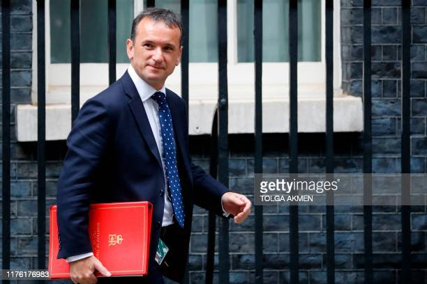 Britain's Wales Secretary Alun Cairns leave from 10 Downing Street in central London on October 16 2019 after attending a meeting of the cabinet...