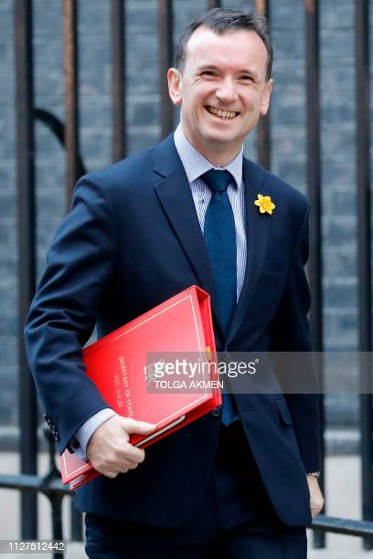 Britain's Wales Secretary Alun Cairns leaves after attending the weekly cabinet meeting at 10 Downing Street in London on February 26 2019 Prime...