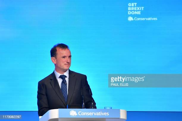Britain's Wales Secretary Alun Cairns speaks on the final day of the annual Conservative Party conference at the Manchester Central convention...