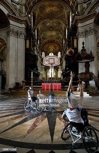 Britain's wheelchair basketball players Sarah Grady Judith Hamer Helen Turner and Louise Sugden practice shooting baskets under the dome in St Paul's...