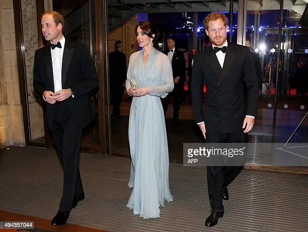 Britain's William, Duke of Cambridge, Britain's Catherine, Duchess of Cambridge and Britain's Prince Harry arrive for the world premiere of the new...