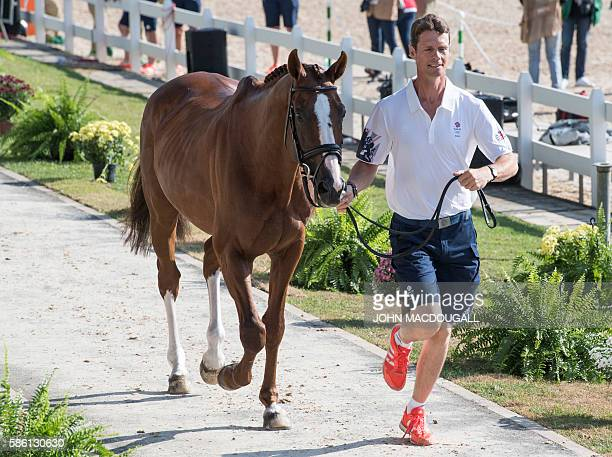 Britain's William FoxPitt leads Chilli Morning to a trot during the first horse inspection of the Equestrian's Eventing phase during the 2016 Rio...