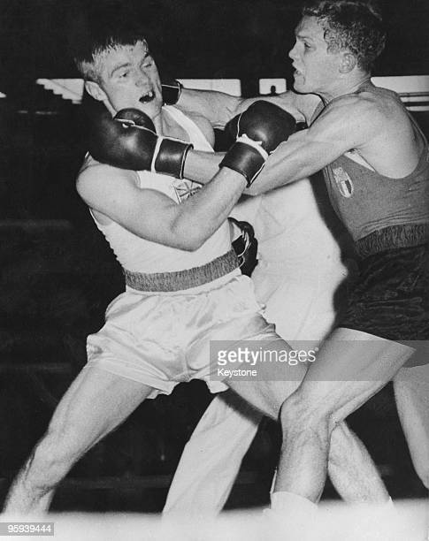 Britain's Willie Fisher and Italian boxer Carmelo Bossi during their light middleweight semifinal at the Rome Olympics 4th September 1960 Bossi won...