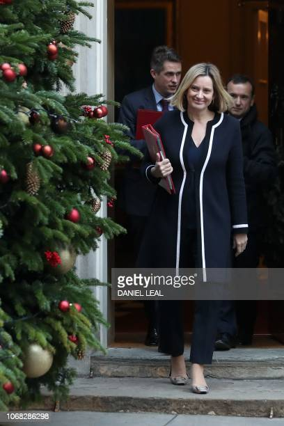 Britain's Work and Pensions Secretary Amber Rudd followed by Britain's Defence Secretary Gavin Williamson and Britain's Wales Secretary Alun Cairns...
