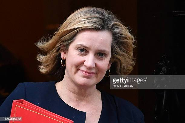 Britain's Work and Pensions Secretary Amber Rudd leaves after attending a Cabinet meeting at 10 Downing Street in London on March 14 ahead of a...