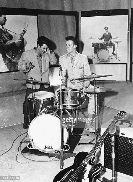 Britain's youngest DJ Gus Goodwin watching musician Vince Eager play the drums, during rehearsals for the BBC show 'Drumbeat', circa 1960.