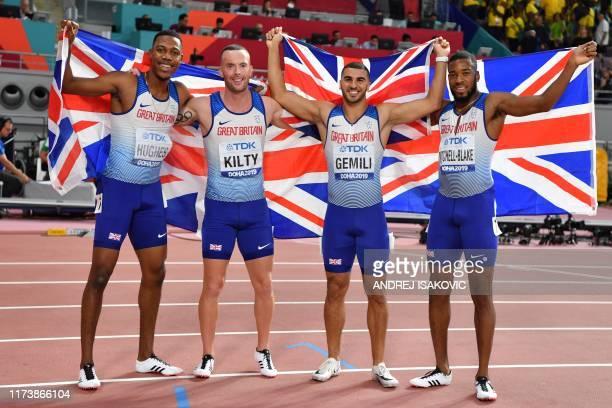 Britain's Zharnel Hughes Britain's Richard Kilty Britain's Adam Gemili and Britain's Nethaneel MitchellBlake celebrate silver after the Men's 4x100m...