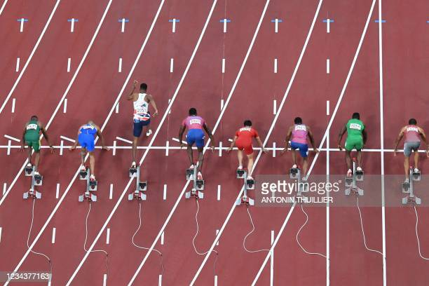 Britain's Zharnel Hughes false starts the men's 100m final during the Tokyo 2020 Olympic Games at the Olympic Stadium in Tokyo on August 1, 2021. /...