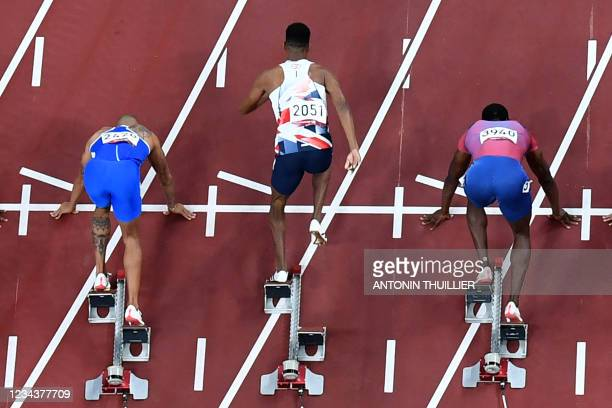 Britain's Zharnel Hughes false starts the men's 100m final during the Tokyo 2020 Olympic Games at the Olympic Stadium in Tokyo on August 1, 2021.