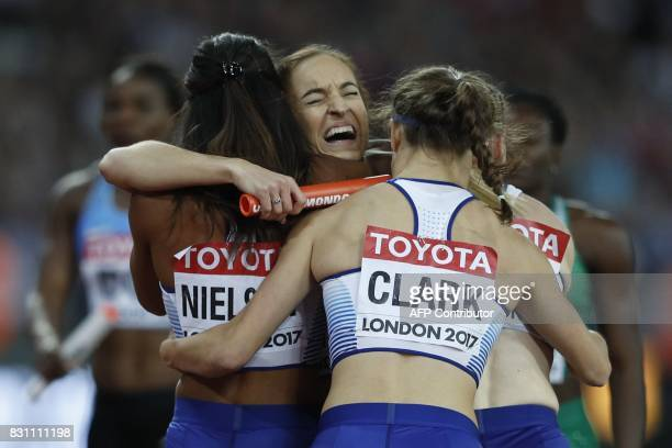 Britain's Zoey Clark Britain's Eilidh Doyle Britain's Laviai Nielsen and Britain's Emily Diamond celebrate silver in the final of the women's 4x400m...