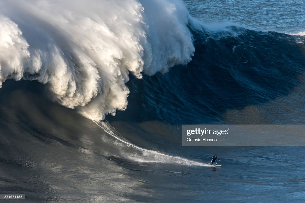 Britan big wave surfer Andrew Cotton drops a wave during a surf session at Praia do Norte on November 8, 2017 in Nazare, Portugal. Cotton suffered a broken back after the wave knocked him off his board.