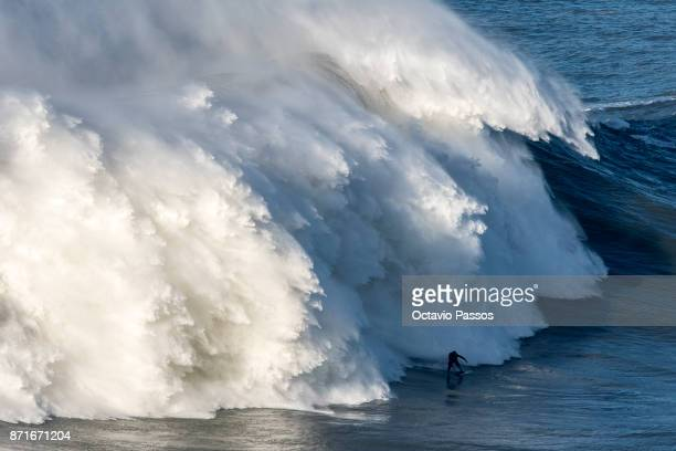 Britan big wave surfer Andrew Cotton drops a wave during a surf session at Praia do Norte on November 8 2017 in Nazare Portugal Cotton suffered a...
