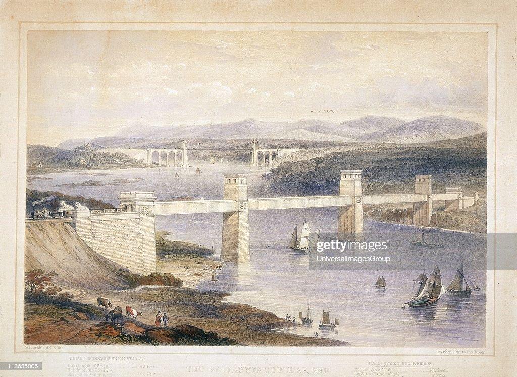 Britannia Tubular Bridge over Menai Straits between Welsh mainland and Angelsea. Chester and Holyhead Railway. Begun 1846, opened 18 March 1850. Engineer Robert Stephenson. Box girder bridge. In background is Telfords road suspension bridge built 1820-182... : News Photo