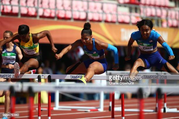 Britany Anderson of Jamaica Tia Jones of The USA and Courtney Jones of The USA in action during the final of the women's 100m hurdles on day six of...