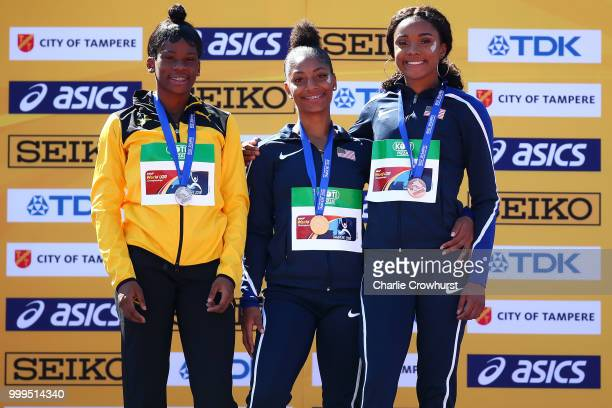 Britany Anderson of Jamaica Tia Jones of The USA and Courtney Jones of The USA celebrate with their medals during the medal ceremony for the women's...