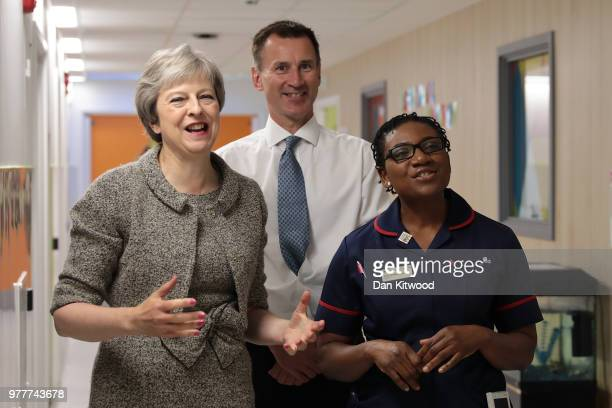 Britiain's Prime Minister Theresa May and Secretary of State for Health and Social Care Jeremy Hunt meet nurses during a visit to the Royal Free...