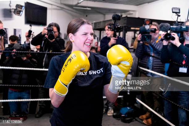 Britian's Liberal Democrats leader Jo Swinson poses as she takes a boxing lesson at Total Boxer a boxing gym offering training to young people as a...