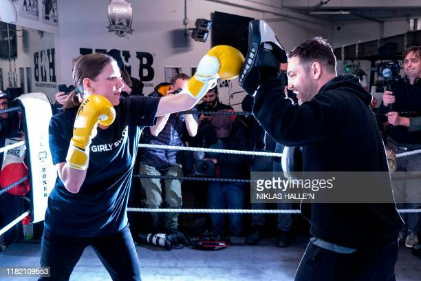Britian's Liberal Democrats leader Jo Swinson takes boxing instruction from gym owner and manager Matt Garcia at Total Boxer a boxing gym offering...
