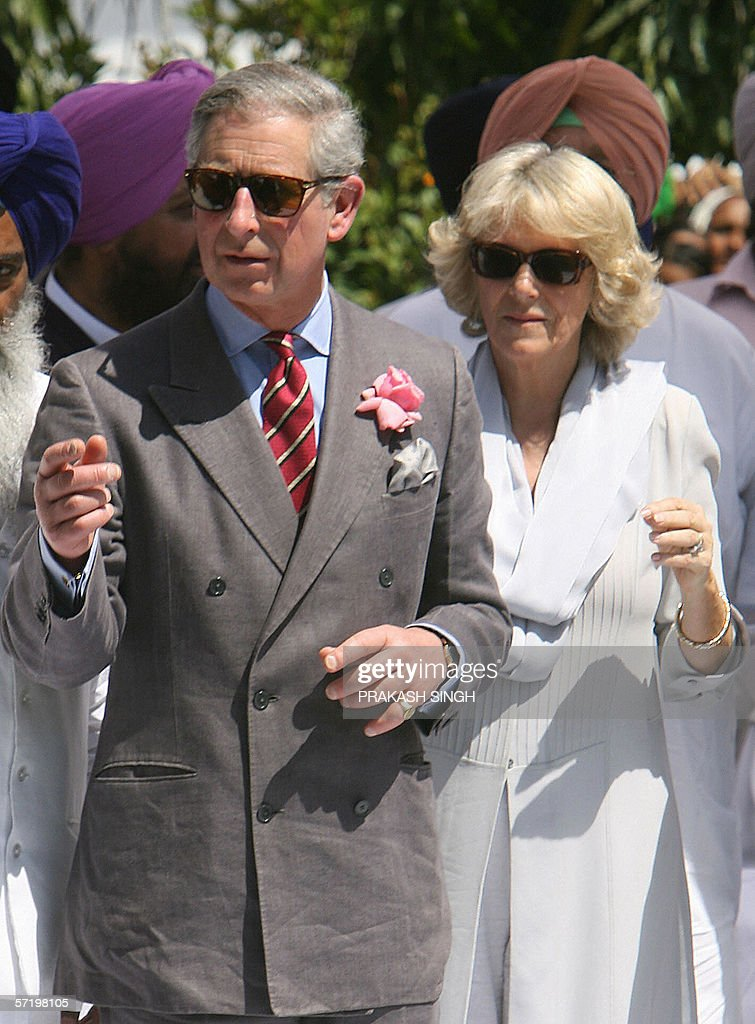 Britian`s Prince Charles and his wife Camilla Duchess of York gesture after their visit at Anadpur Saheb Gurudwara in the town of Anadpur Saheb some..