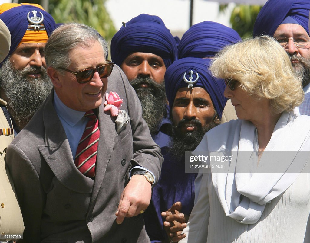 Britian`s Prince Charles and his wife Camilla Duchess of York pose with Gatka traditional Sikh martial art players at Anadpur Saheb Gurudwara in the..