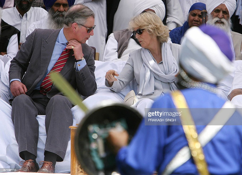 Britian`s Prince Charles and his wife Camilla Duchess of York watch `Gutka` a traditional Sikh martial art at Anadpur Saheb Gurudwara in the town of..