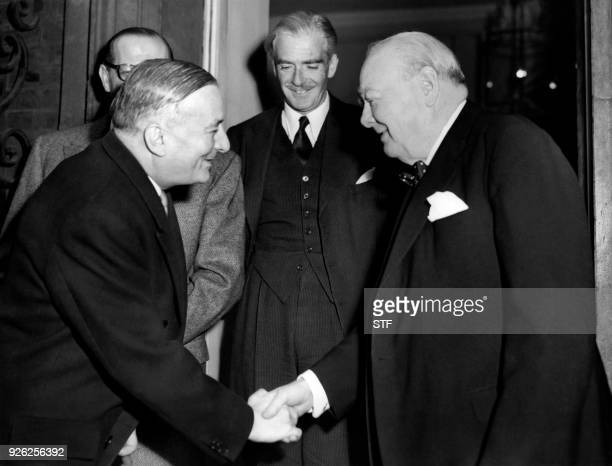 Britis Prime Minister Winston Churchill shakes hands with French Foreign Affairs minister Georges Bidault after a lunch at 10 Downing Street in...
